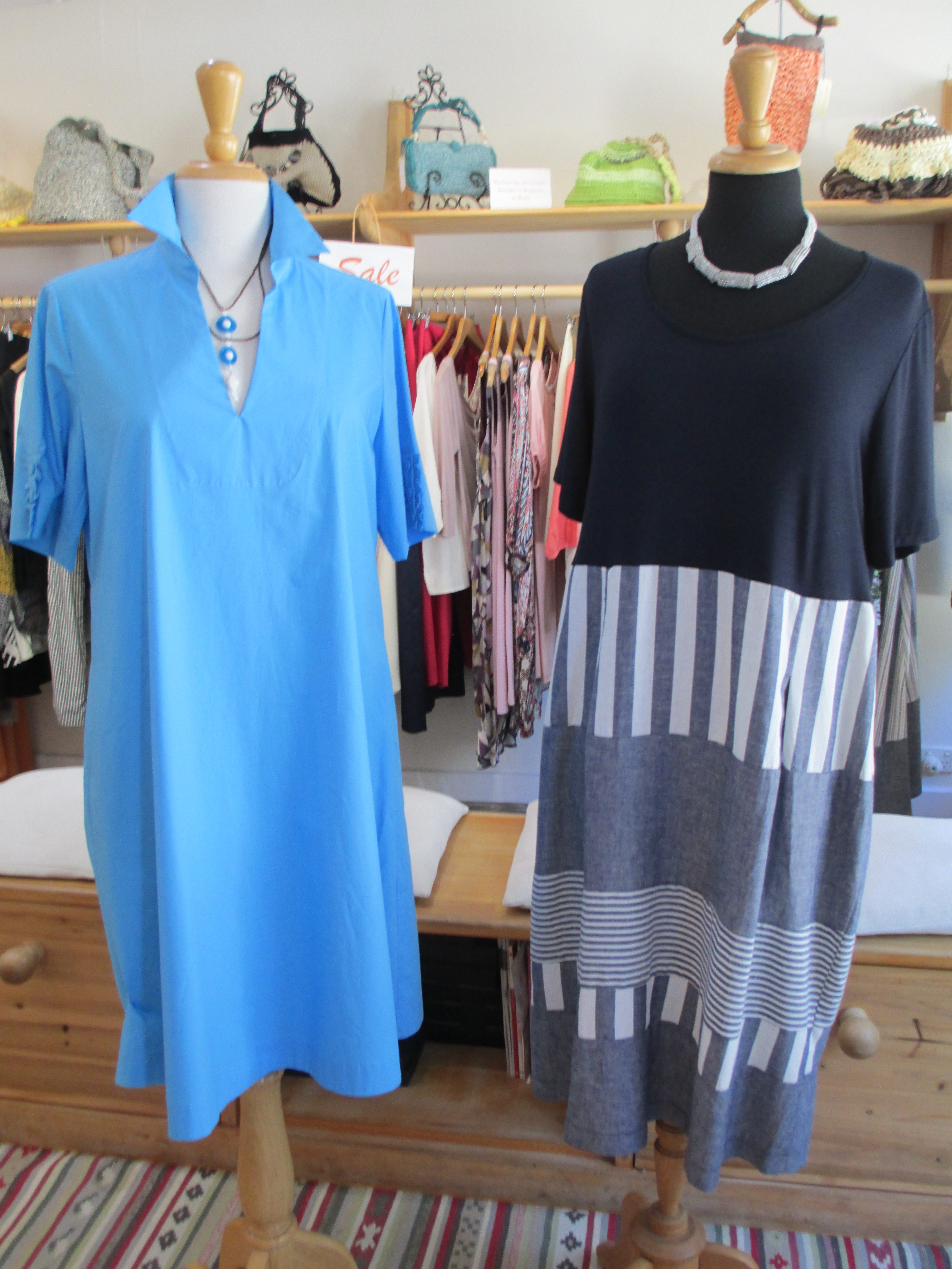 From left to right:  Short sleeve 100% cotton Turquoise dress made in Italy; Brown & Blue YUNGI necklace made of recycle glass, design in Milan Italy and Handmade by Maasai Women in Tanzania.